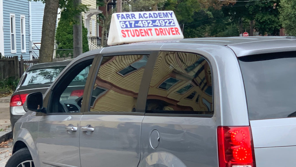 Car with driver's education sign