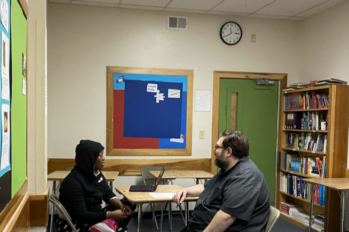 Student and teacher in a classroom